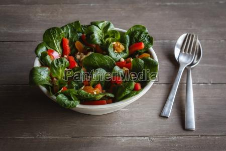 bowl of mixed salad fork and
