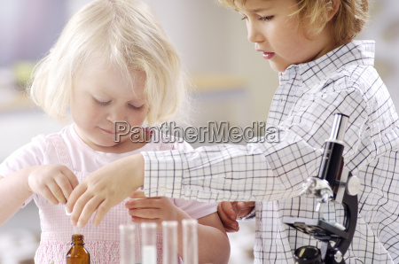 two little children playing with utensils