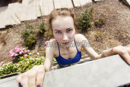 young woman doing chin ups on