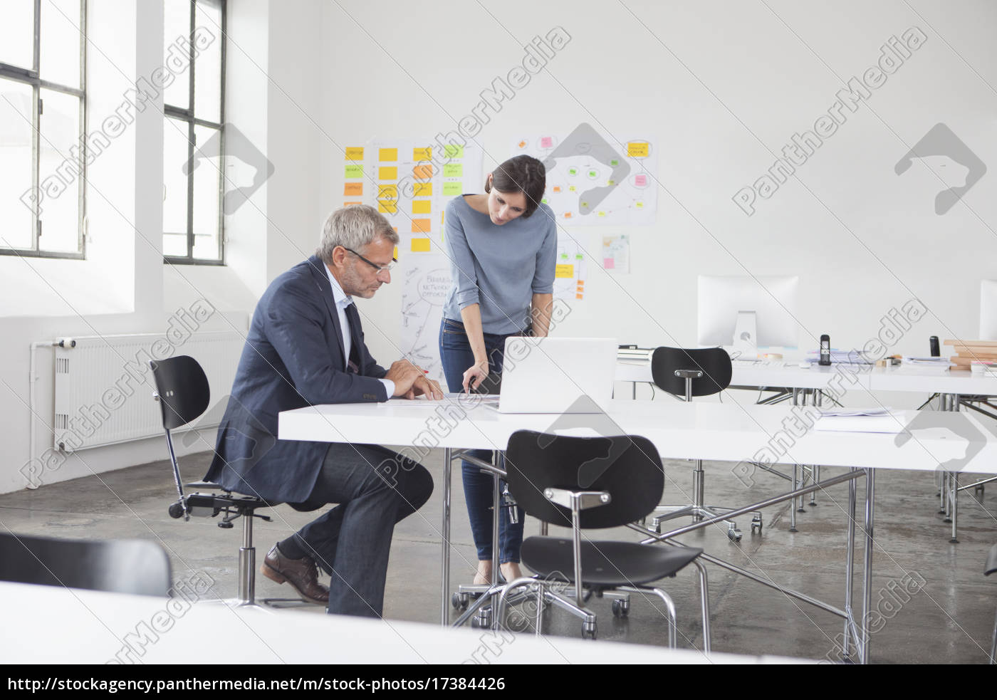 businessman, and, two, in, office, looking - 17384426