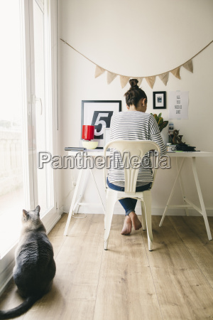 woman working in home office with