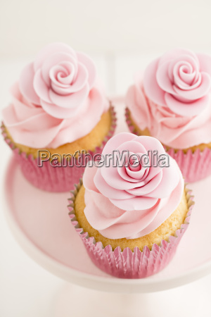 three pink cup cakes close up