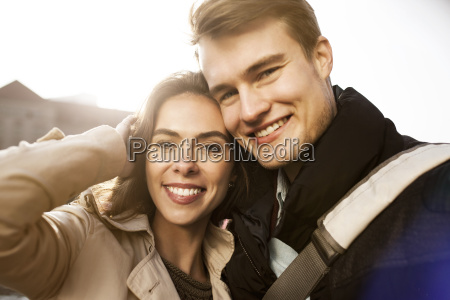 portrait of smiling young couple outdoors