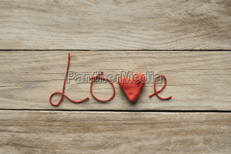 the word love formed of red