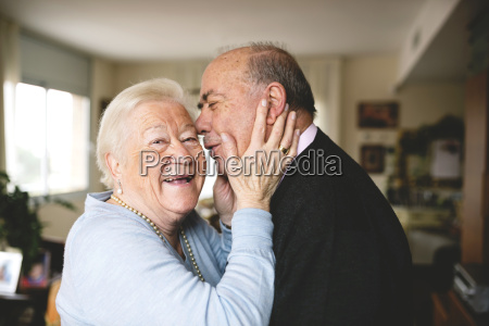 affectionate senior couple at home