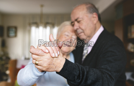 hands of senior couple dancing together
