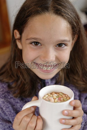 portrait of happy girl holding cup