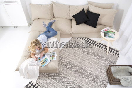 woman lying on the couch in