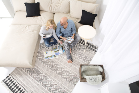 couple sitting on the floor of