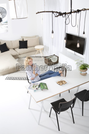 woman sitting with feet up on