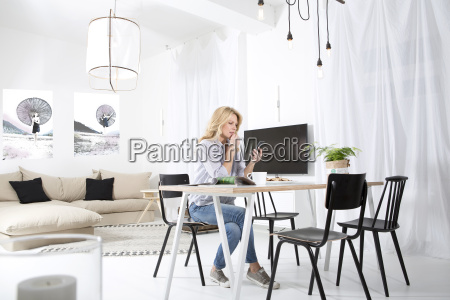 woman sitting at the table in