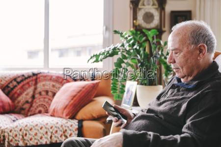 senior man sitting in the living