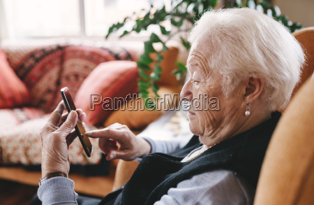 senior woman sitting in the living