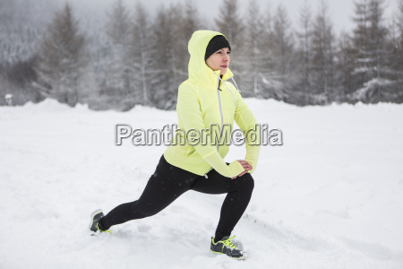 woman warming up for cross country