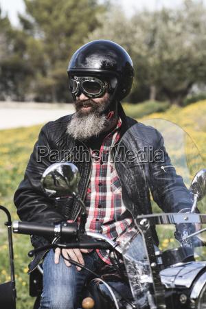 portrait of biker wearing helmet and