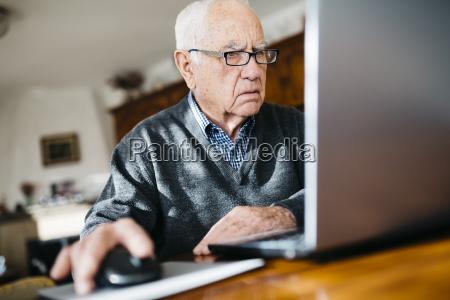 portrait of serious looking senior man