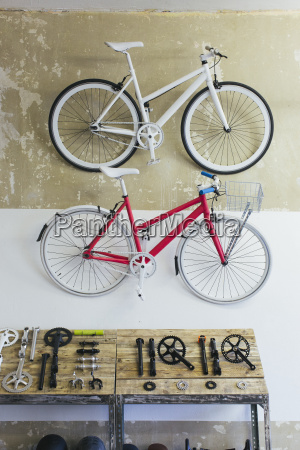 two custom made bicycles hanging on