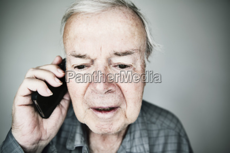 portrait of senior man telephoning with
