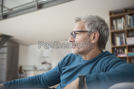 relaxed man at home sitting on