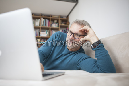 mature man at home lying on