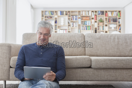 smiling man sitting in front of