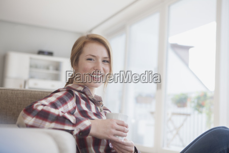 portrait of smiling young woman relaxing