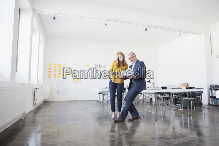 businessman and coworker discussing project in