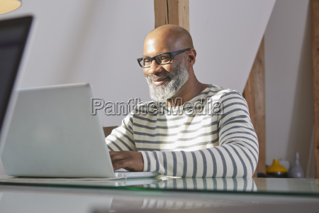 portrait of smiling man sitting