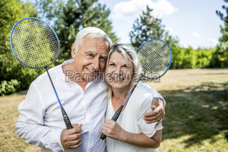 portrait of smiling elderly couple on