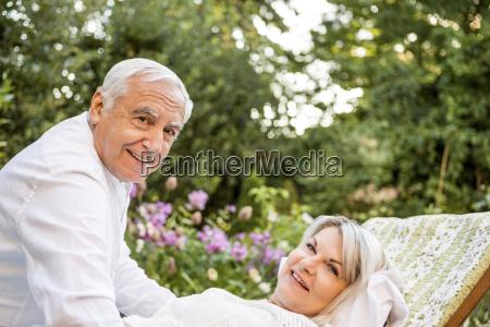 relaxed elderly couple in garden