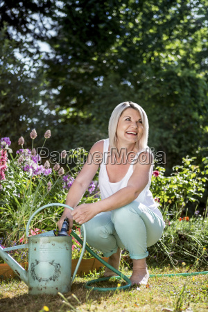 smiling mature woman with hose and