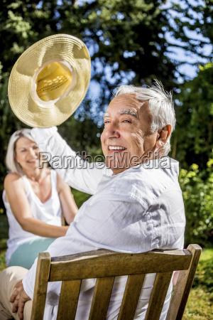happy senior man in garden with