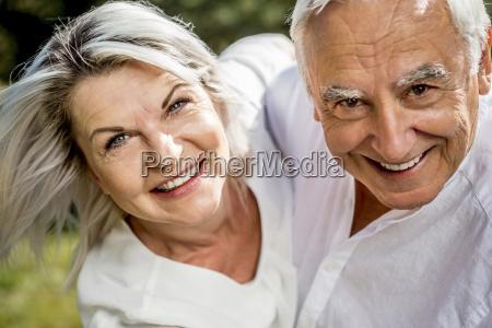 portrait of happy elderly couple outdoors