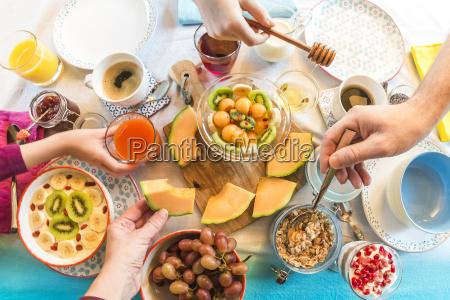 breakfast laid table fresh muesli hands