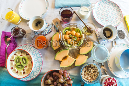 laid breakfast table with muesli and