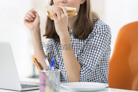 young woman at office desk with