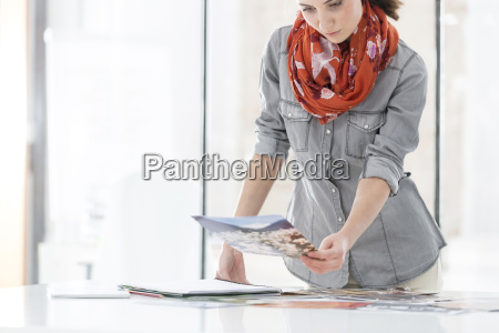 young woman in office looking at