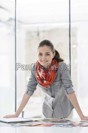 smiling young woman in office with