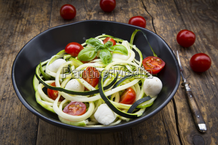 bowl of zucchini spaghetti with mozzarella