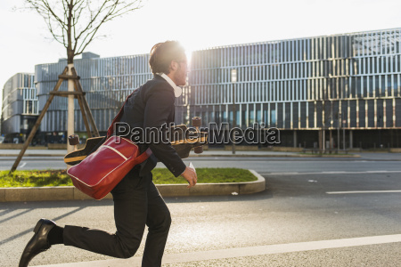 germany frankfurt young businessman running with