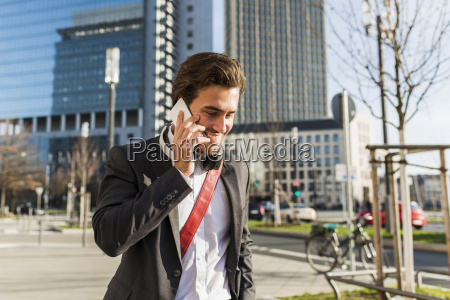 germany frankfurt young businessman walking the