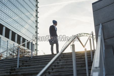 germany frankfurt young businessman standing on