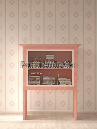 rosa vitrine mit buecher vor gemusterten