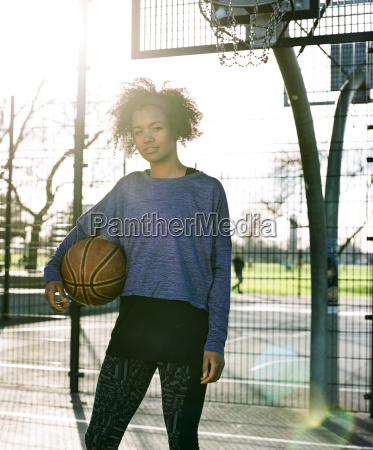 portrait of young woman with basketball