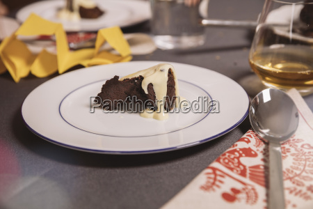 plate with christmas pudding and custard