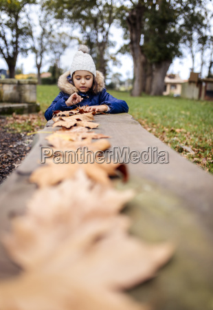 portrait of little girl playing with