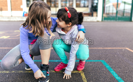 two little girls playing together on