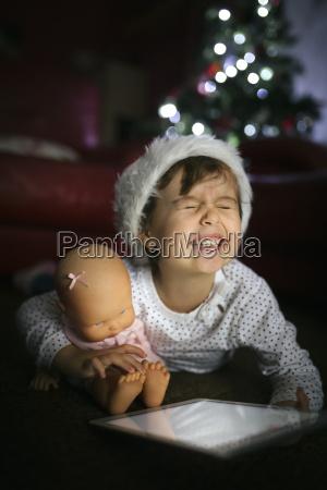 portrait of little girl wearing christmas