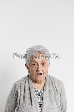portrait of surprised senior woman in