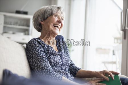 portrait of happy senior woman sitting